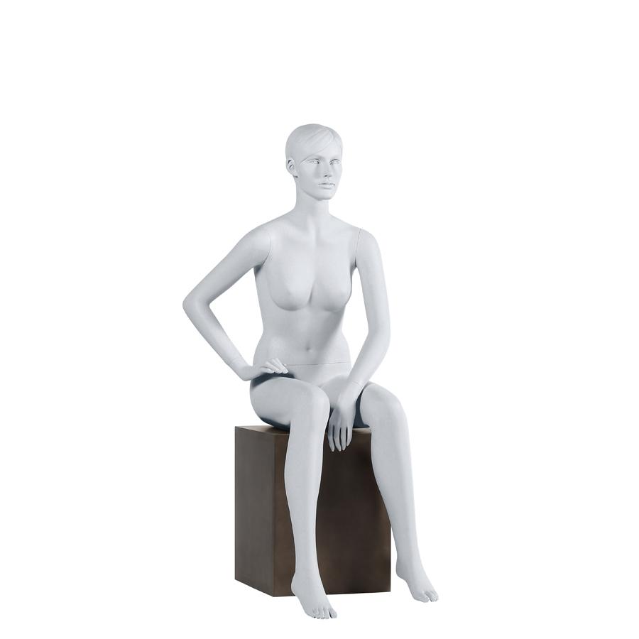 Sitzende Schaufensterpuppe weiblich